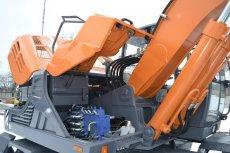 Колесный экскаватор E200W UMG